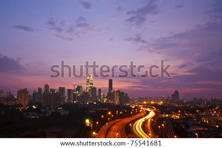 Stunning light trail at highway in Kuala Lumpur city - stock photo