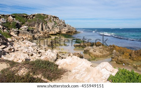 Stunning limestone bluffs and Indian Ocean waters at Penguin Island in Rockingham, Western Australia/Limestone Bluffs/Penguin Island, Rockingham, Western Australia - stock photo