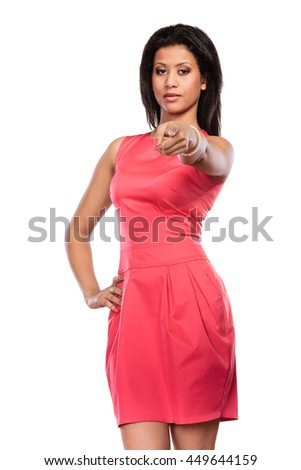 Stunning mixed race african american woman in red dress pointing at you. Gorgeous young girl isolated on white. Fashion. - stock photo