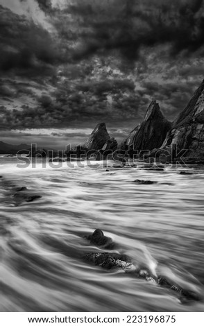 Stunning mountain and sea sunset landscape  black and white - stock photo