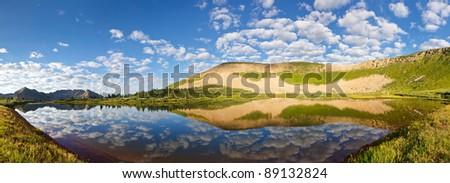 Stunning mountain lake panorama in the Rocky Mountains, Colorado. - stock photo