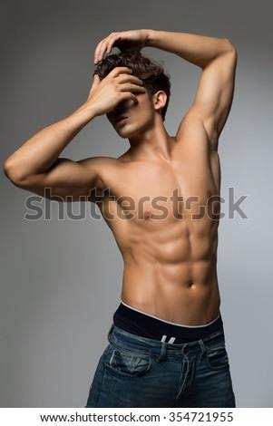 Stunning muscular young men bodybuilder posing  - stock photo