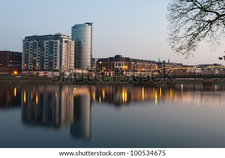 stunning nightscene with Riverpoint buildings and Shannon bridge (over Shannon river) in Limerick, Ireland (picture taken after sunset) - stock photo