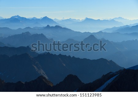 Stunning panorama  in the Alps with a majestic view on the high peaks of the Ecrins Massif National Park, France. - stock photo