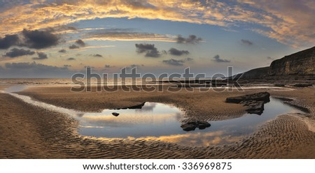 Stunning panorama sunset landscape over Dunraven Bay in Wales