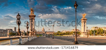 Stunning Pont Alexandre III bridge (1896) spanning the river Seine. Decorated with ornate Art Nouveau lamps and sculptures it is the most extravagant bridge in Paris. - stock photo