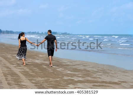 Stunning sensual portrait of interracial happy couple isolated with copy space. Asian woman,Caucasian man  - stock photo