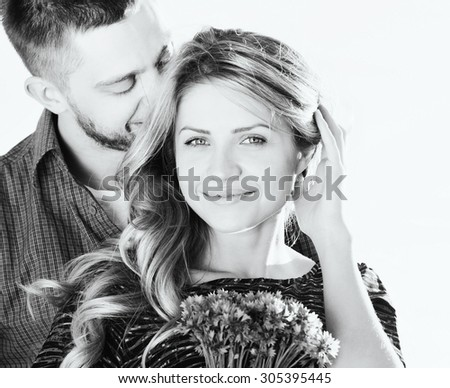 stunning sensual young couple in love posing in summer field, happy lifestyle concept