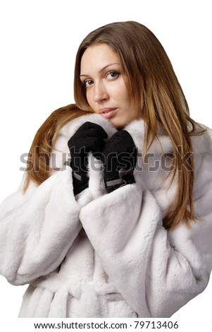 stunning sexy young woman in fur coat isolated on white background - stock photo