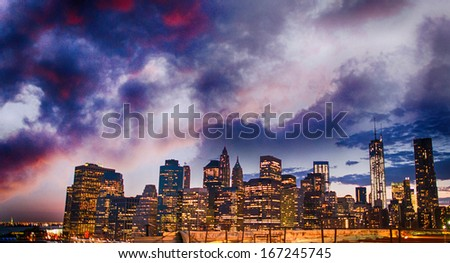 Stunning skyline of New York City at summer sunset. Manhattan skyscrapers.