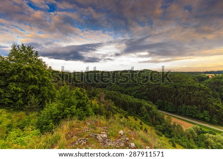Stunning Summer Evening Landscape in the rural Countryside of Bavaria, Germany. Lovely hills and woods in the franconian switzerland near a picturesque country road