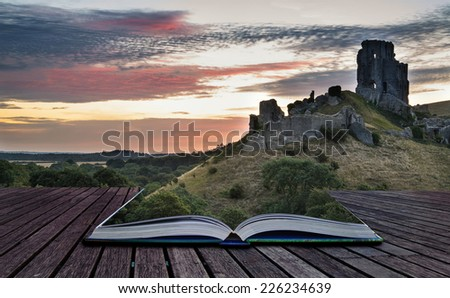 Stunning sunrise landscape over ruins of medieval castle conceptual book image - stock photo