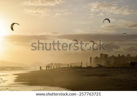Stunning sunset in Rio de Janeiro with silhouette of kite surfers - stock photo