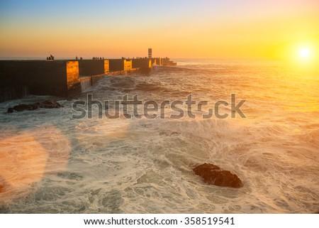 Stunning sunset on the coast, while the surf. - stock photo