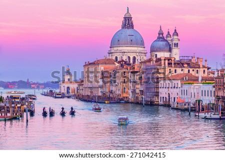 Stunning sunset over Grand Canal and Basilica Santa Maria della Salute in Venice, Italy.
