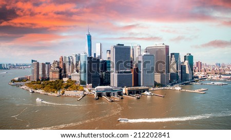 Stunning sunset over lower Manhattan. Aerial view of New York, Hudson and East River. - stock photo