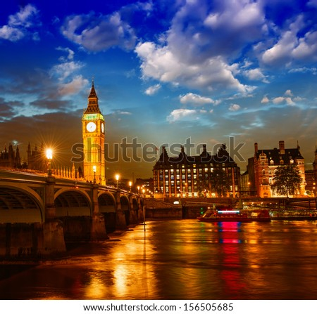 Stunning sunset view of London skyline. The Houses of Parliament and Westminster Bridge with Big Ben Tower. - stock photo