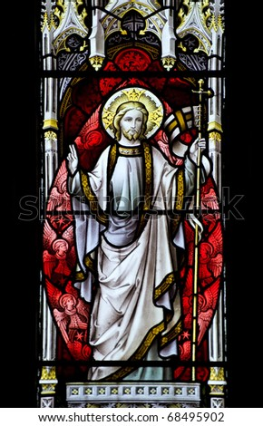 Stunning 15th Century stained glass window detail with vibrant colors and excellent detail  of resurrected Jesus - stock photo