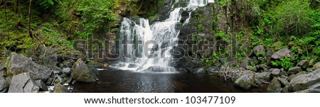 stunning Torc waterfall in the Killarney National Park, Ireland (panoramic picture with 180 angle view) - stock photo