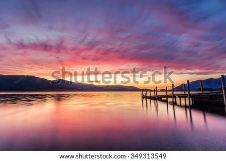 Stunning Vibrant Sunset At Ashness Jetty In Keswick, The Lake District, UK. - stock photo