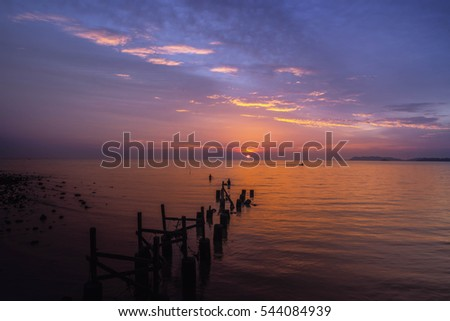 Stunning vibrant sunset at jetty of fisherman beach, at Pasir Panjang Port Dickson Negeri Sembilan. Soft Focus due to Long Exposure Shot.