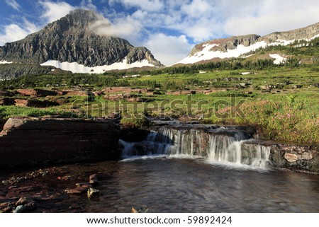 Stunning view of Reynolds Creek and Mountain in Glacier National Park, Montana. - stock photo