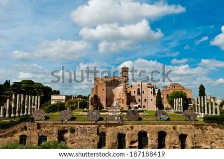stunning view of Temple of Venus and Roma seen from the Colosseum in Rome, Italy. This Temple is thought to have been the largest in Ancient Rome. - stock photo