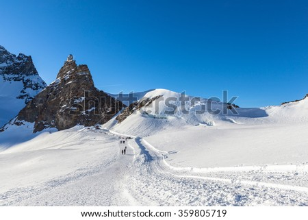Stunning view of the famous peak Jungfrau of swiss Alpsand and the Sphinx Observatory, one of the highest astronomical observatories in the world, from Jungfraujoch, Bernese Oberland, Switzerland. - stock photo
