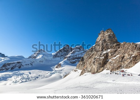 Stunning view of the famous peak  Jungfrau of swiss Alpsand  and the Sphinx Observatory, one of the highest astronomical observatories in the world, from Jungfraujoch on Bernese Oberland, Switzerland. - stock photo