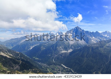 Stunning view of the Mont Blanc massif including the peak of Aiguille Verte and the town Chamonix,  France - stock photo