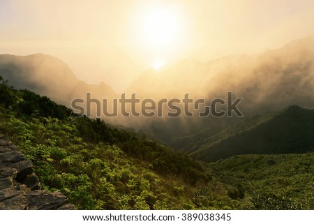 Stunning views of the sunset over the mountains in the clouds. Tenerife, Canary Islands. Spain - stock photo
