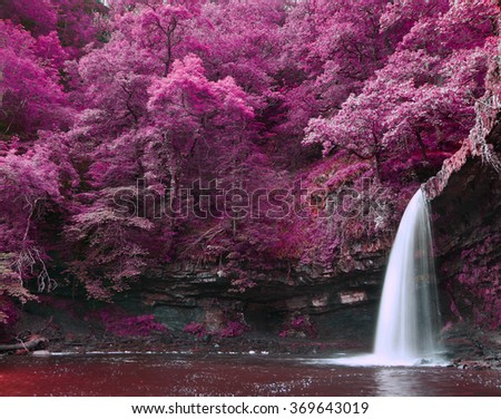 Stunning waterfall in alternate surreal colored landscape - stock photo