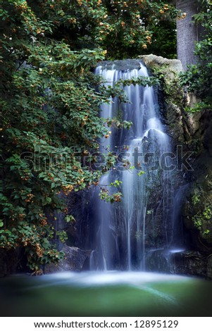 stunning waterfall in lush outdoor setting - stock photo