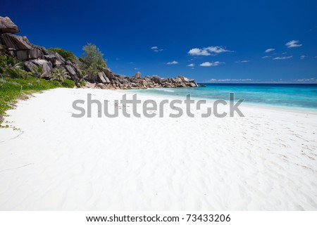 Stunning white sand beach at La Digue island in Seychelles - stock photo