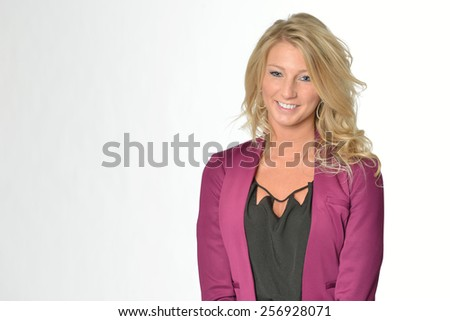 Stunning young blonde woman in business attire - fuscia jacket and black blouse - stock photo