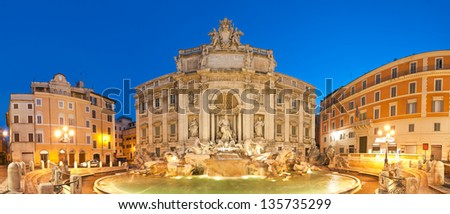 Stunningly ornate Trevi Fountain (1762) illuminated at night in the heart of Rome. - stock photo
