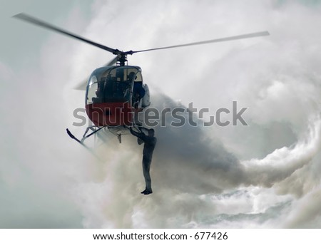 Stunt Man Hanging on Helicopter - stock photo