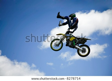 stunt man up in the clouds - stock photo