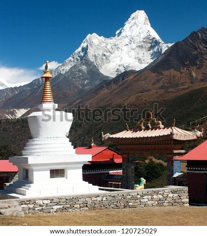 Stupa in Tengboche monastery with mount Ama Dablam on the way to Everest base camp - stock photo