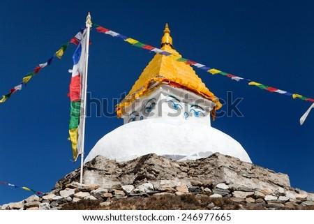 Stupa near Dingboche village with prayer flags - way to mount Everest base camp - Khumbu valley - Nepal - stock photo