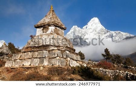 Stupa near Pangboche village with mount Ama Dablam - way to mount Everest base camp - Khumbu valley - Nepal - stock photo