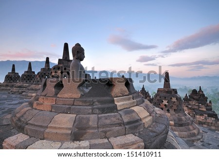 Stupas and Statue of Buddha at Borobudur Temple, Yogjakarta Indonesia. - stock photo