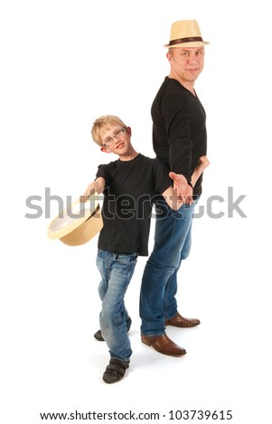 Sturdy father and son making performance in studio - stock photo