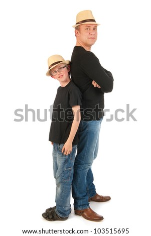 Sturdy father and son standing in the studio - stock photo