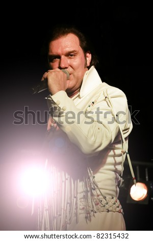 "STUTTGART - AUGUST 04: The musician and singer ""Eric Prinzinger"" in concert at summer Festival Stuttgart August 04, 2011 in Stuttgart, Germany. - stock photo"