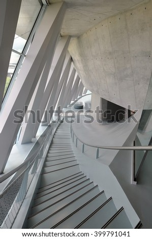 STUTTGART, GERMANY - APRIL 22, 2014: Interior of the modern museum of cars Mercedes-Benz. View of the curve stairs in perspective. Stuttgart, Germany. - stock photo