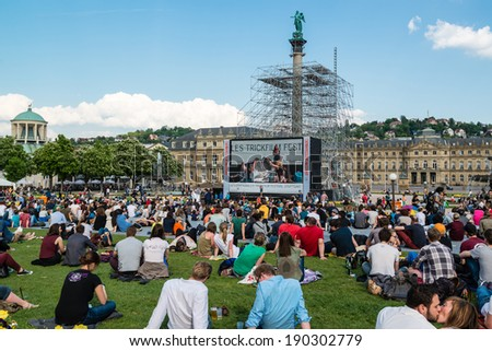 STUTTGART, GERMANY - APRIL 24, 2014: People are enjoying  the open air cinema in the city center on a sunny day during the 21st International Trickfilm Festival on April, 24,2014 in Stuttgart, Germany - stock photo