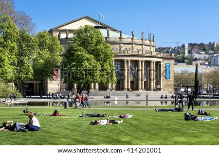 Stuttgart, Germany - April 20, 2016: People relax in front of the Opera house in the capital of Baden-Wuerttemberg
