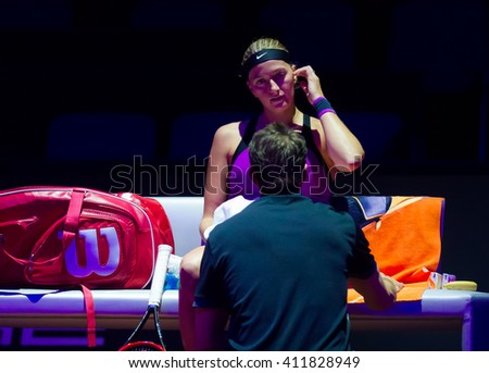 STUTTGART, GERMANY - APRIL 21, 2016: Petra Kvitova listens to her coach during a changeover at the 2016 Porsche Tennis Grand Prix