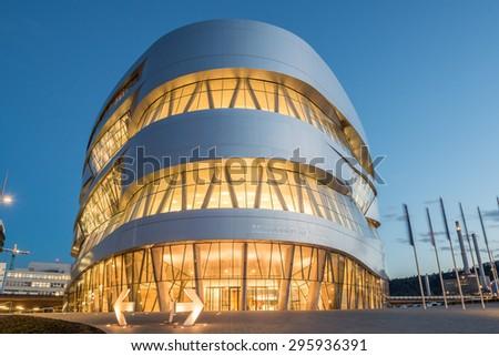 STUTTGART, GERMANY - February 20, 2014: Spectacular modern architetcur and home of  Museum Mercedes-Benz Welt in Stuttgart, shot at  HDR Golden Hour. - stock photo